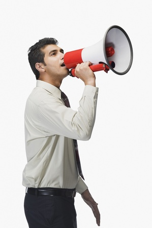 loudspeaker: Businessman announcing into a megaphone