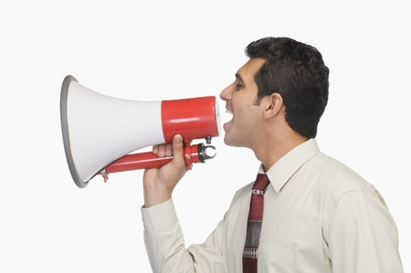 Close-up of a businessman announcing into a megaphone Stock Photo - 10124164