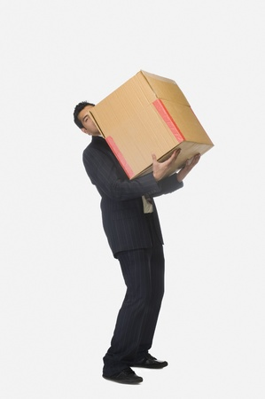 Businessman holding a cardboard box Stock Photo - 10123926
