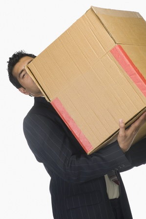 Businessman holding a cardboard box Stock Photo - 10166263