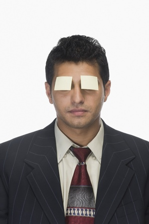 Adhesive notes on a businessman's eyes Stock Photo - 10166227