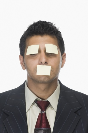 Adhesive notes on the eyes and mouth of a businessman Stock Photo - 10169450