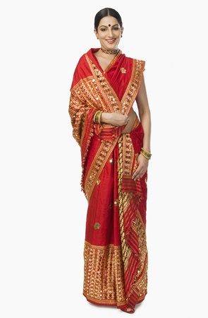 indian subcontinent ethnicity: Woman in bright red mekhla