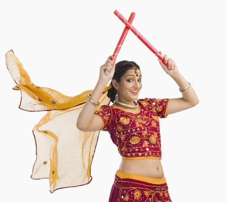 Woman in lehenga choli performing dandiya dance Stock Photo - 10124469