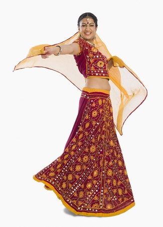indian subcontinent ethnicity: Woman dancing in bright red lehenga choli