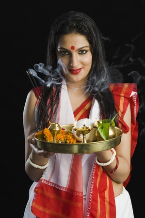 pooja: Beautiful woman in a Bengali sari holding pooja thali LANG_EVOIMAGES