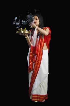 Beautiful woman in a Bengali sari holding pooja thali Stock Photo - 10123899