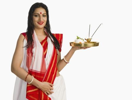 Woman in a Bengali sari holding pooja thali Stock Photo - 10124172