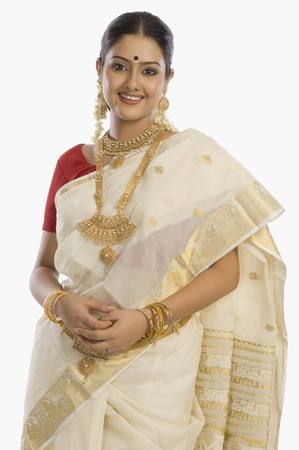 indian subcontinent ethnicity: Portrait of a South Indian woman wearing jewelry and sari