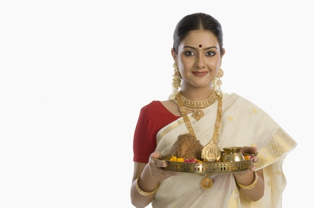 Portrait of a South Indian woman holding a plate of religious offerings Stock Photo - 10124091