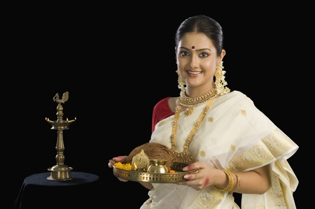 Portrait of a South Indian woman holding a plate of religious offerings Stock Photo - 10124308