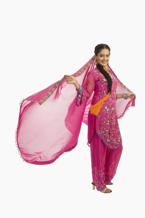 kameez: Portrait of a woman posing in salwar kameez
