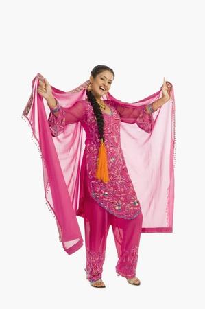 salwar: Portrait of a woman dancing in salwar kameez