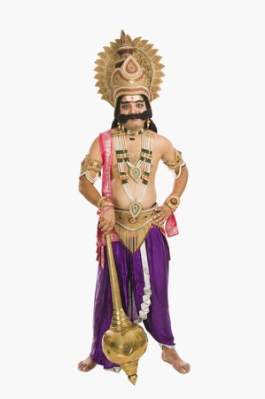 Portrait of a man dressed-up as Ravana the Hindu mythological character and holding a mace Imagens