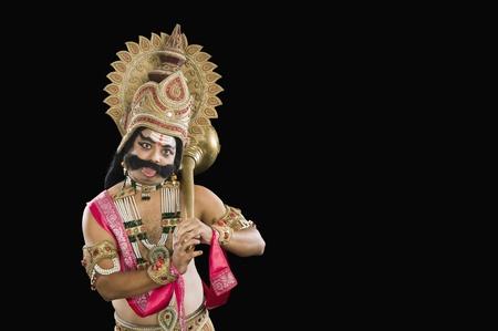Retrato de un hombre vestido como Ravana y pegue su lengua a Foto de archivo - 10124362