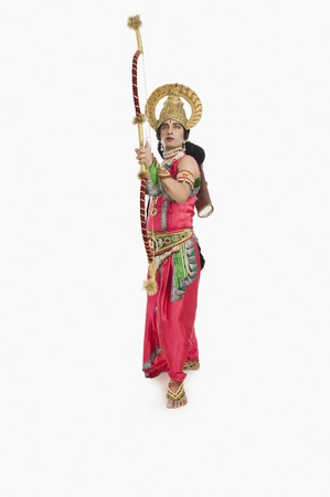 Man dressed-up as Rama and holding a bow and arrow Stock Photo - 10123936