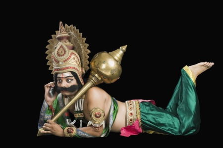 Man dressed-up as Ravana talking on a mobile phone Stock Photo - 10124588