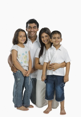 indian subcontinent ethnicity: Portrait of a family smiling