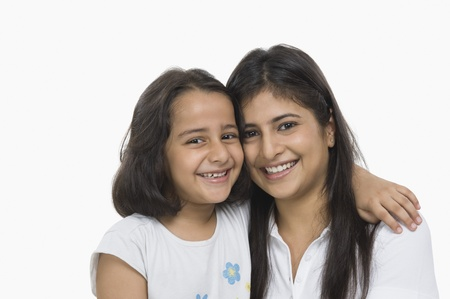 indian subcontinent ethnicity: Woman hugging her daughter and smiling