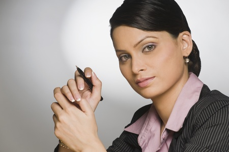 Close-up of a businesswoman holding a pen Stock Photo - 10166476