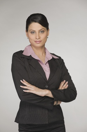 indian people: Portrait of a businesswoman with arms crossed LANG_EVOIMAGES