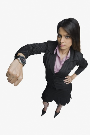 getting late: Businesswoman showing a wristwatch