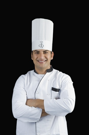 chefs whites: Portrait of a chef smiling LANG_EVOIMAGES