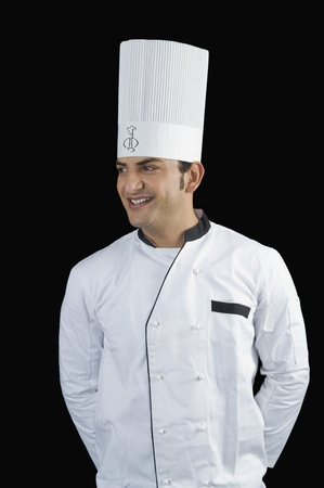 Chef standing with hands behind back and smiling Stock Photo - 10124126