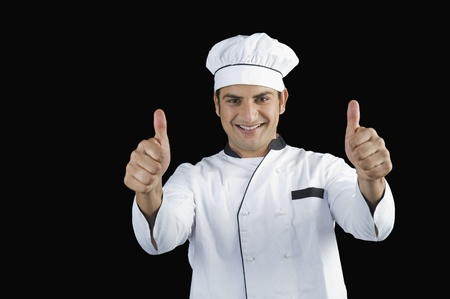 Portrait of a chef gesturing thumbs up sign Stock Photo - 10123971