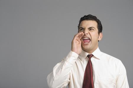 formal shirt: Businessman shouting LANG_EVOIMAGES