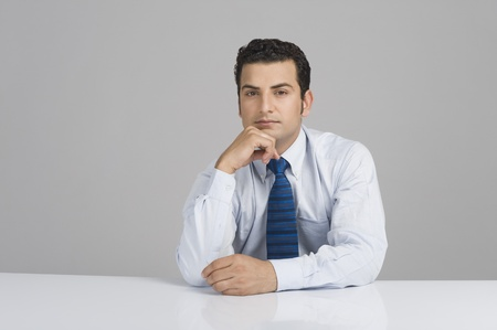 Portrait of a businessman thinking Stock Photo - 10125402