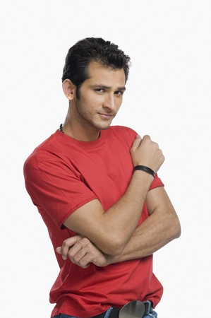 Portrait of a man standing with his arms crossed Imagens