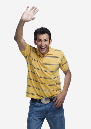 Portrait of a man waving his hand and laughing Standard-Bild