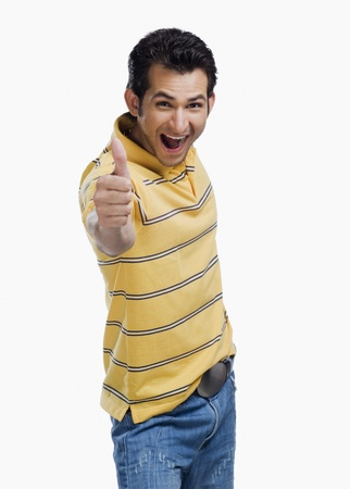 Portrait of a man showing thumbs up sign Stock Photo - 10125071