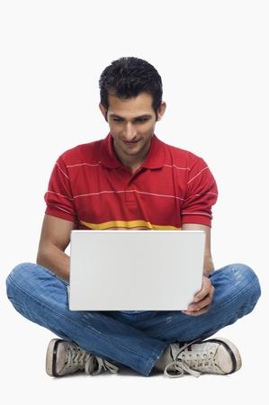 Close-up of a man using a laptop Stock Photo - 10169487