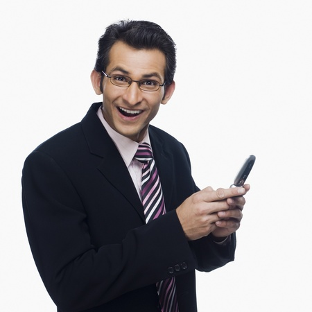 clipping  messaging: Portrait of a businessman looking surprised while text messaging