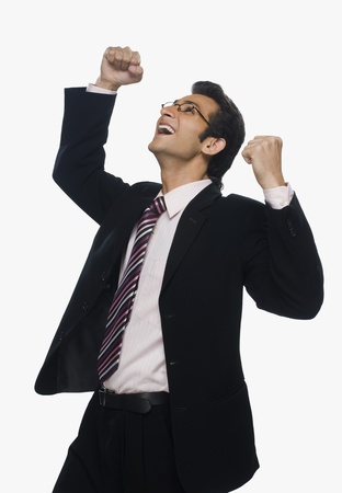 otimismo: Close-up of a businessman cheering LANG_EVOIMAGES