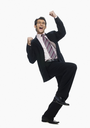 Close-up of a businessman cheering 版權商用圖片