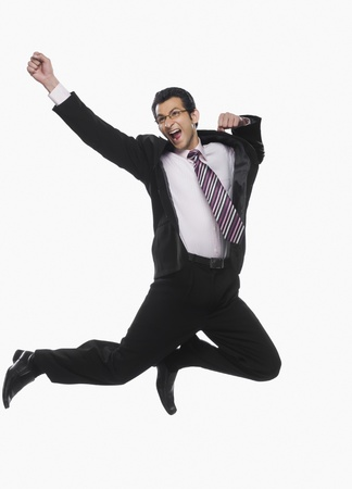 cheer full: Businessman jumping