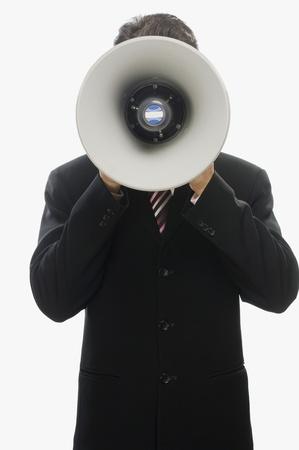 businessman using a megaphone: Businessman using a megaphone