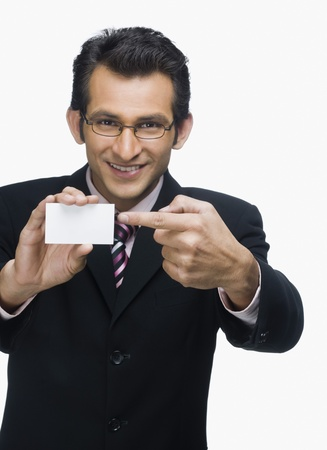 index card: Portrait of a businessman showing a business card LANG_EVOIMAGES
