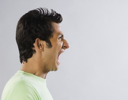 Close-up of a man screaming Stock Photo