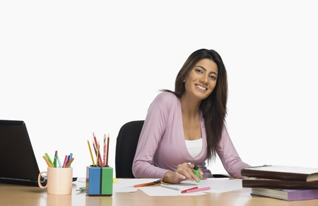 Female fashion designer working in an office Stock Photo - 10125751