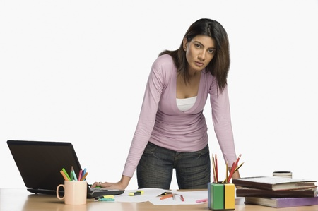 creativity: Female fashion designer working in an office LANG_EVOIMAGES