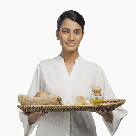 Woman holding a tray of products for aromatherapy Stock Photo - 10124321