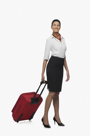 Air hostess carrying her luggage Stock Photo - 10124112