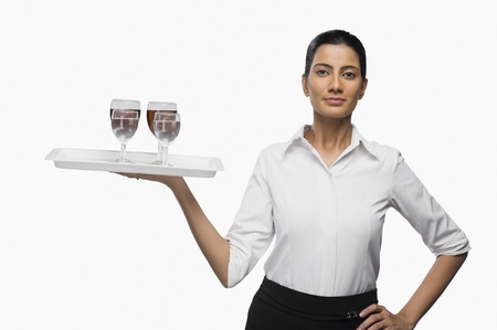 Air hostess carrying a tray of wine glasses Stock Photo - 10125884