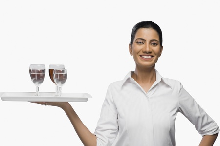 air hostess: Air hostess carrying a tray of wine glasses