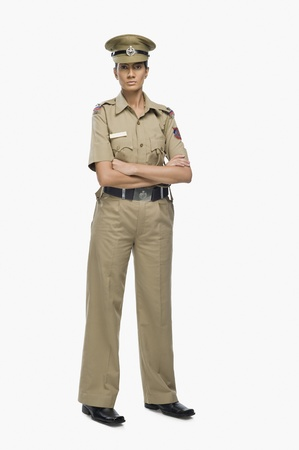 Portrait of a female police officer with her arms crossed Stock Photo - 10123894