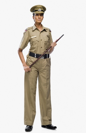 Portrait of a female police officer holding a stick Stock Photo - 10125761